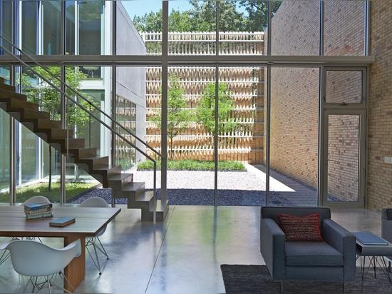 Thayer Brick House is hidden behind a brick screen