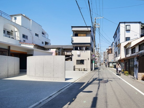 fujiwaramuro architects uses arched concrete walls to divide this house in osaka