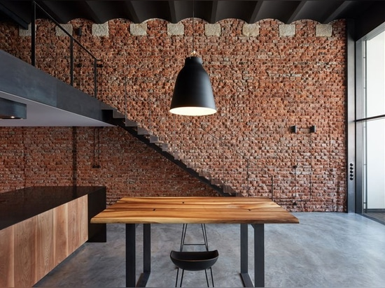 abandoned brewery storage units in prague restored into industrial lofts by CMC architects