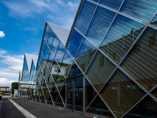 tezuka architects designs tomioka town hall with a distinctive jagged roofline