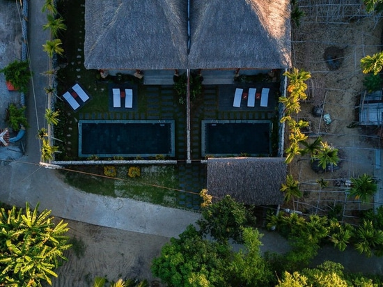D1 builds duplex villa in vietnam with local materials and a coconut leaf roof