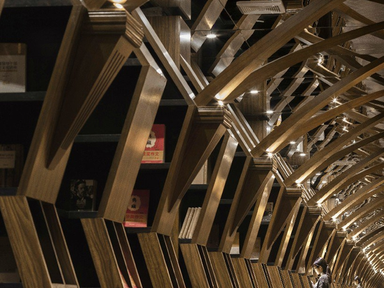 x+living combines wooden structures and mirrors in mesmerizing chinese bookstore