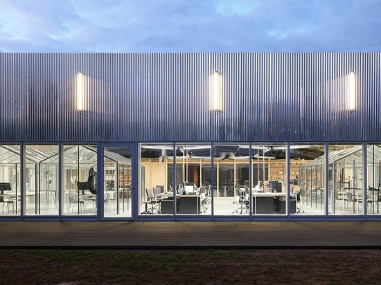 freaks wraps a double skin of corrugated stainless steel around office building in france