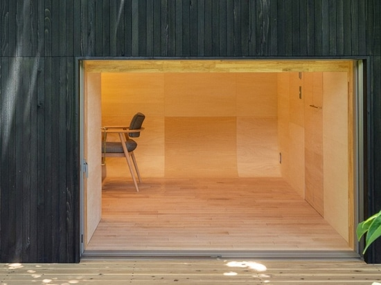 tunnel by takehiko suzuki architects is a small hut in tokyo clad in charred japanese cedar