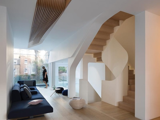 Sculptural Wood Elements Are A Feature Found Throughout This House In London