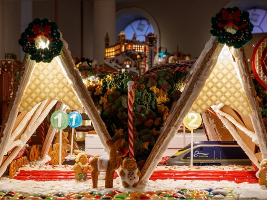 "The Gingerbread City is complete with a working train in Grimshaw's envisioning of the London ""Bridge Roll Station."""