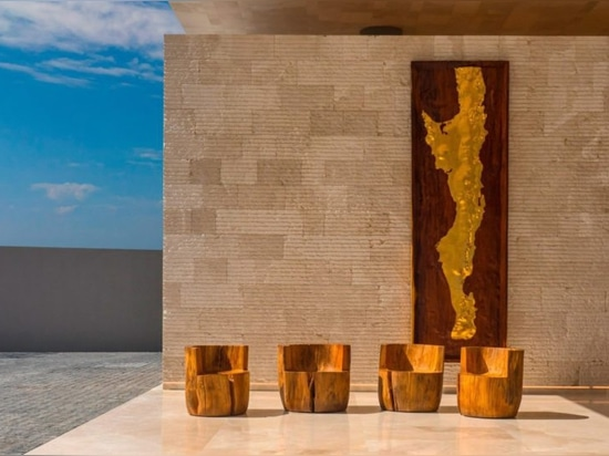 Mexican artist César López Negrete unobtrusively tells the history of Los Cabos through a series of sculptural works found across the 34-acre property, including this golden topographic relief gree...
