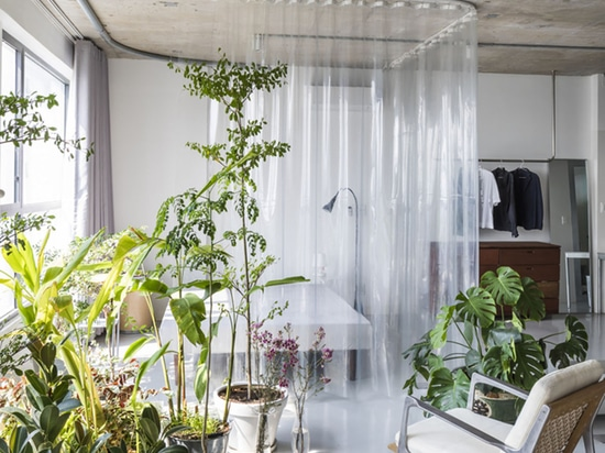 Nhabe Scholae Creates Landscape-Like Interior With Translucent Curtains Inside An Apartment