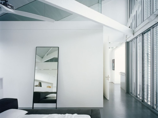 Internal walls shift to glazing above door height, revealing the full extent of the existing trusses.