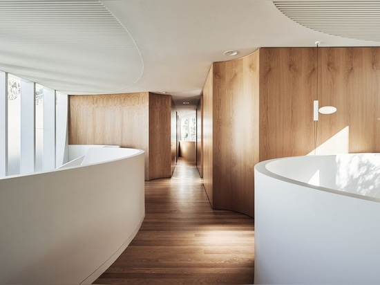 Upstairs, the points where adjacent walls meet are made concave to skirt around downlights.