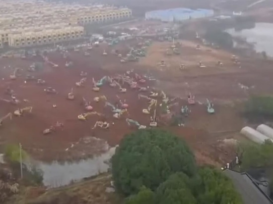 Bulldozers began leveling a site Thursday in Wuhan.