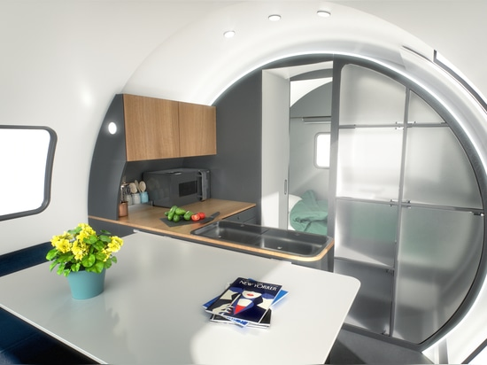 The kitchen is equipped with a refrigerator and cooktop. Add-on options include a microwave and oven.
