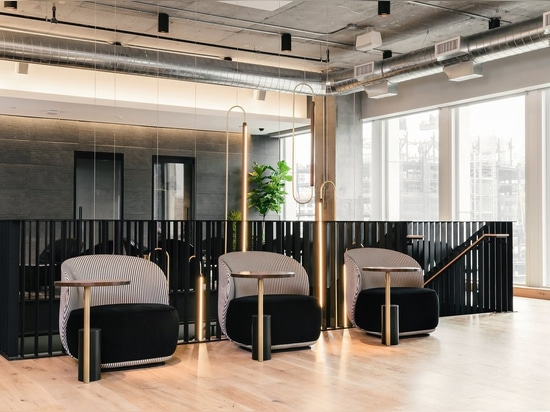 On the second level of the coworking space, individual lounge chairs with work surfaces are a grown-up version of a school desk.