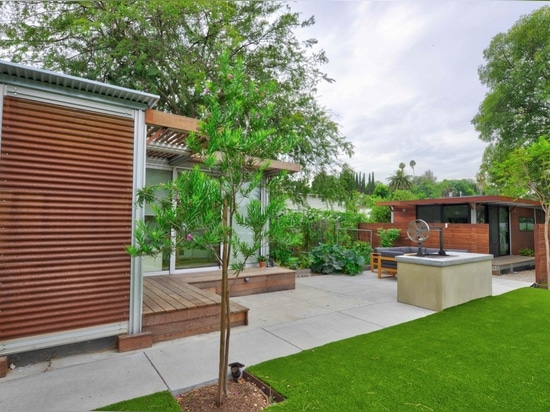 Customized with add-on decks and canopies, this k9 project is wrapped in ipe planking and Corten corrugated siding.