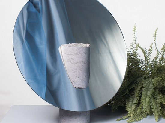 Hanna-Liisa Haukka designed a mirror set into a rough-cut limestone cylinder