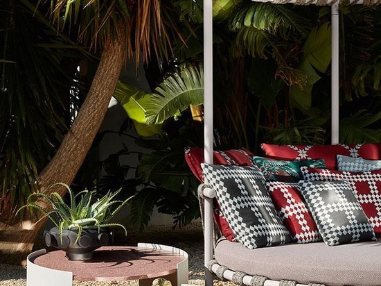 Patricia Urquiola's Trampoline love bed with Bowy outdoor low table.