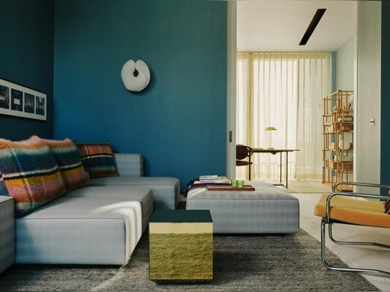 The Television room features a Wendelbo Raft Sofa, custom upholstery in Backhausen 'Rebbio Grande', Porro Modern Light bench in black metal and antique armchair supplied by Retrouvious, Moonati wal...
