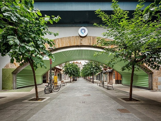 VAUMM reconditions railway arches with mint green colored-tiles in spain