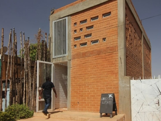 Local earth bricks form this inspiring co-working space in Ouagadougou