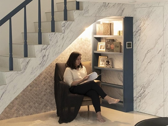 A Small Reading Nook Under The Stairs Makes Use Of An Otherwise Awkward Space