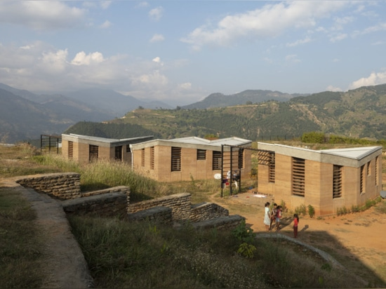 The campus includes housing for the hospital's staff constructed using rammed earth.