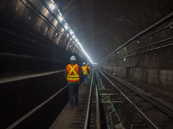Construction workers putting the finishing touches on the Canarsie Tunnel in March of this year.
