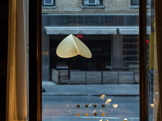 Made from a folded disc of brass, Zahn's 'Bounce' light for Brooklyn lighting brand Roll & Hill is included in one of the displays