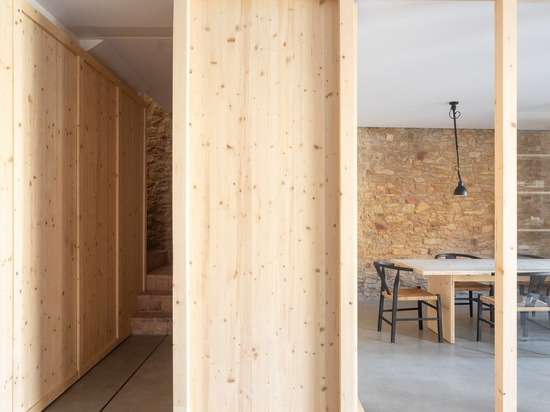 Nordest Arquitectura uses wooden partitions to convert old barn into offices for its studio