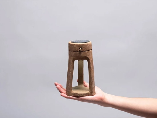 'adobe' by luis fernando sánchez barrios is a handmade solar lamp made of mud, with cactus slime and recycled paper