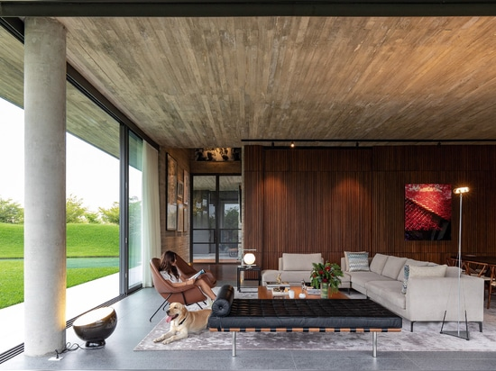 The open plan dining and TV room forms the heart of the house
