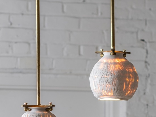 The pendant lights are suspended using brass fixings