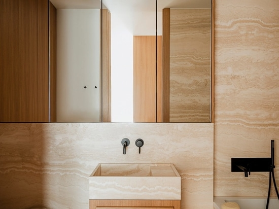 Travertine marble also covers surfaces in the bathroom