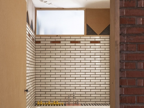 Glazed bricks line the wet areas and bathrooms