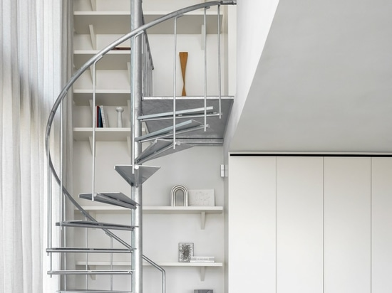 A galvanised-steel staircase connects the apartment's two floors