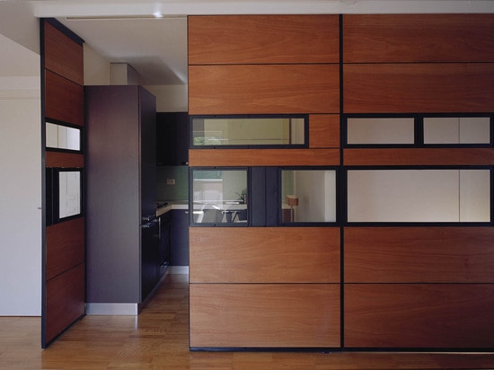 Each unit has its own kitchen , bathroom, bedroom and living area, but the visual continuity was established through the use of similar materials- parquet flooring, wood paneling, light cuts in the...