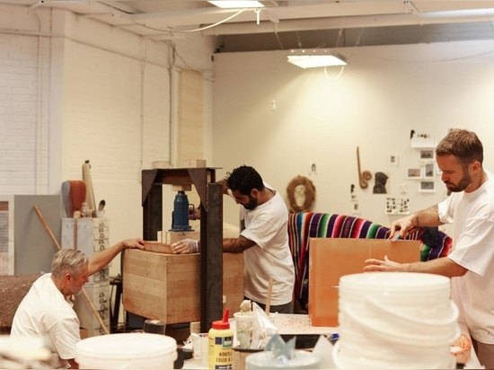 Hozan Zangana, Joseph Crickett and Luuk Disvelt working on the pieces ahead of the installation in Dubai