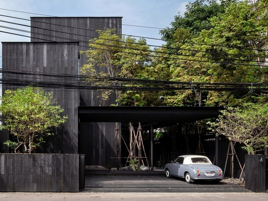 Charred wood and greenery conceal IDIN Architects' Office in Thailand