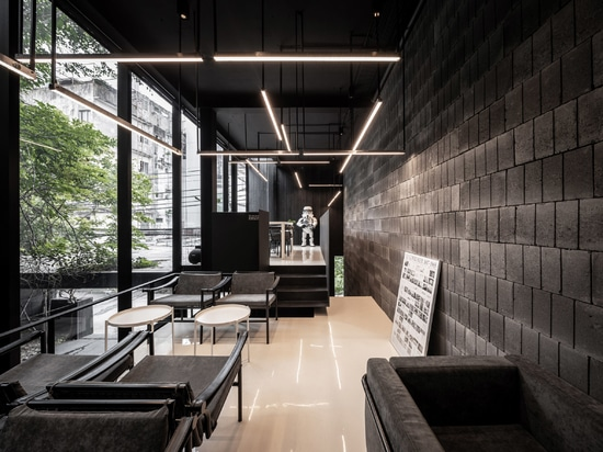 Black walls inside the office mirror the exterior cladding