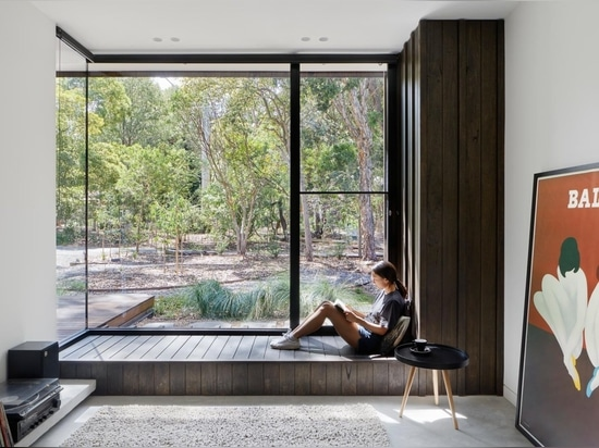 An Exterior Of Blackbutt Timber Hides The Bright White Interior Of This Home