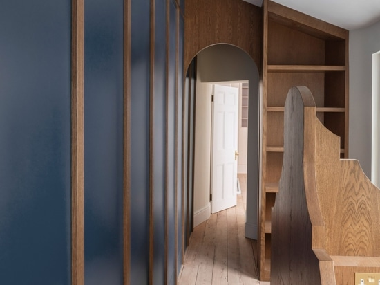 The apartment's study features contrasting blue panelling