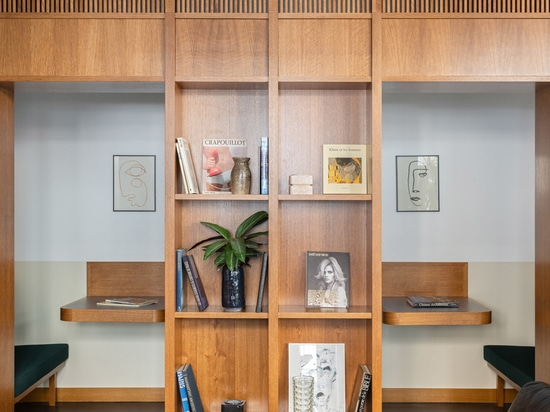 An oak partition is inbuilt with private work booths