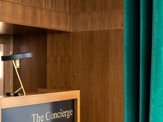 The concierge desk can be screened off by heavy green curtains