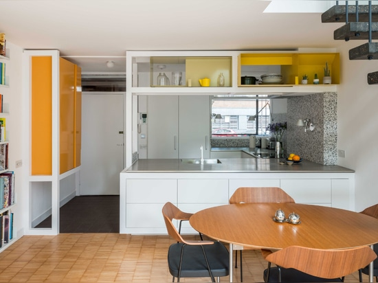 Wooden frames create subtle separation between kitchen and living spaces