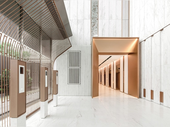The marble is offset by bronze accents throughout