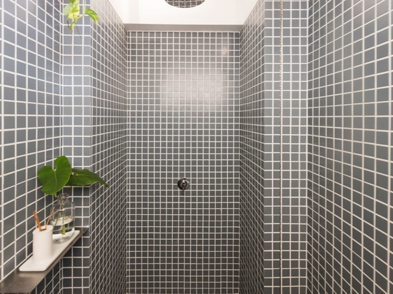 At the rear of the office is a tiled bathroom