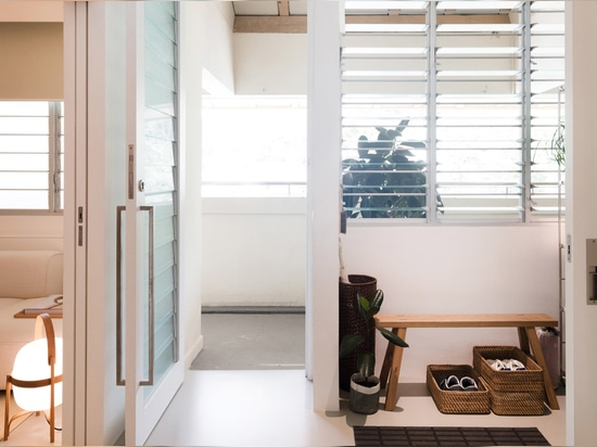 The foyer leads through into the right-hand side of the apartment, which includes a relaxed break-out area