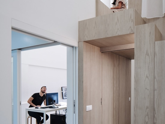 A wall opening by the tea room provides elevated views over the office