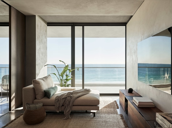 Living areas feature plaster walls and concrete floors