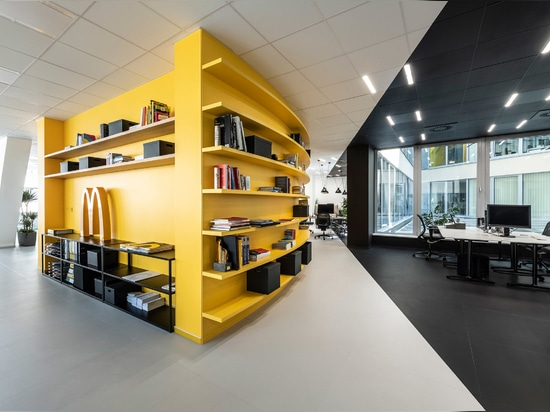 """A yellow """"war room"""" punctuates the open-plan office"""