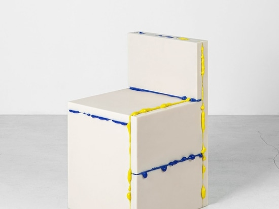 The chair is formed from slabs of white, virgin plastic